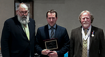 Tom Tracy receiving the first John R. Tracy Award